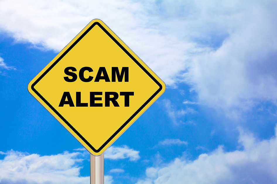 Image of a scam alert sign